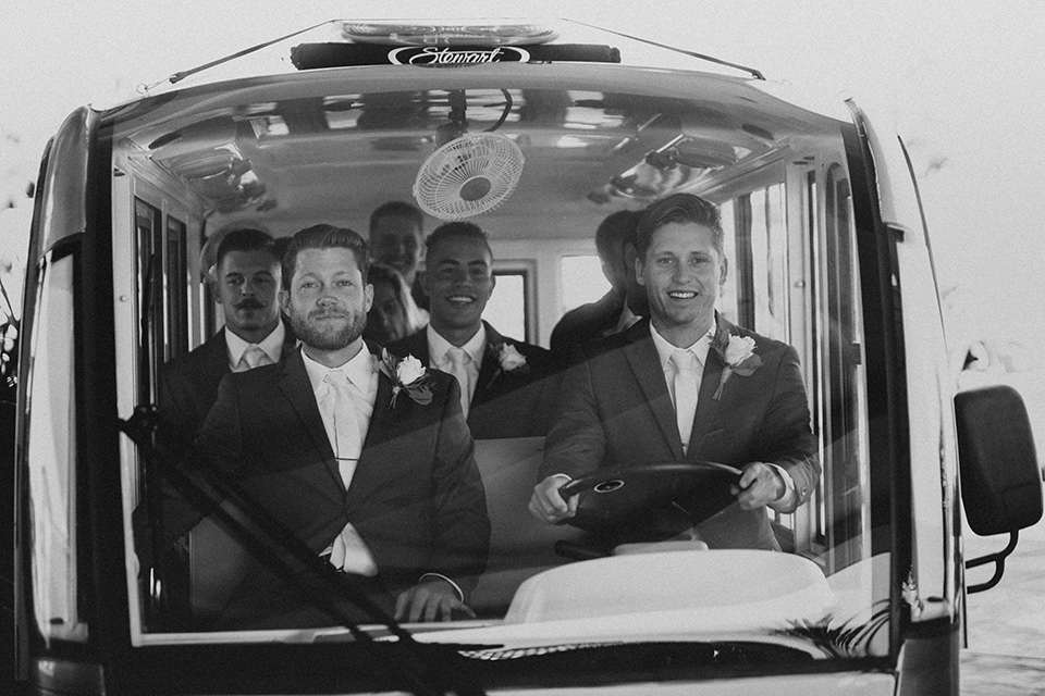 monarch-beach-resort-groom-driving-the-van-groom-in-a-grey-suit-with-ivory-long-tie