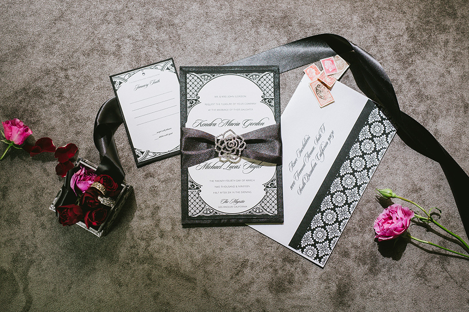 majestic-downtown-los-angeles-shoot-invitations-in-black-with-white-cursive-and-pink-floral-touches