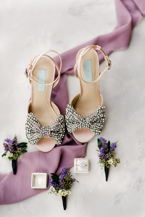 crystal bridal shoes with purple ribbon