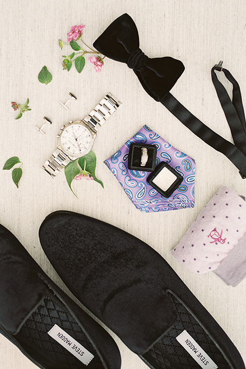 grooms velvet loafers with black bow tie and purple accessories