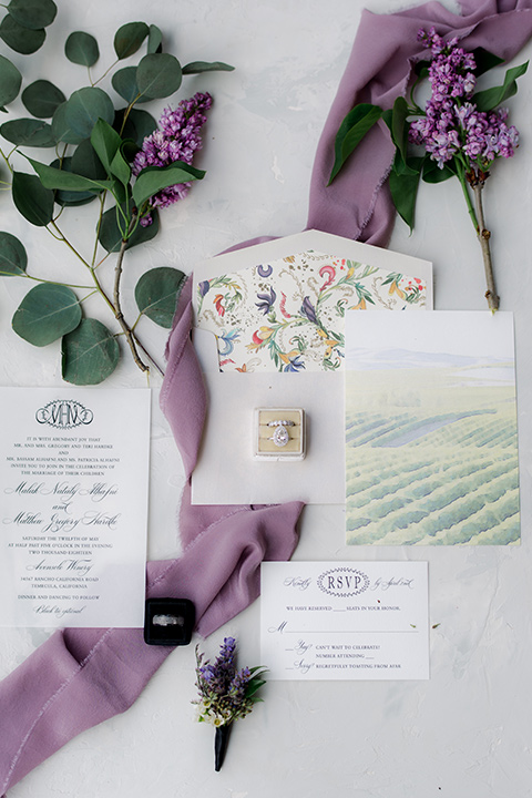 white invitations with green accents