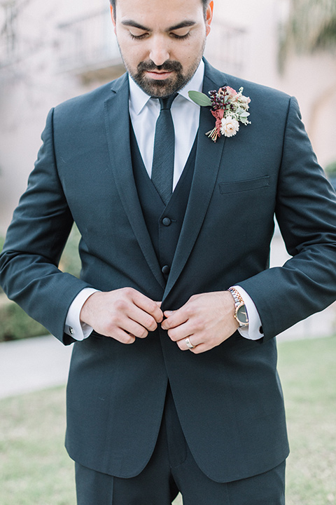 Maxwell-House-Shoot-groom-buttoning-jacket-in-a-black-suit-with-a-black-long-tie