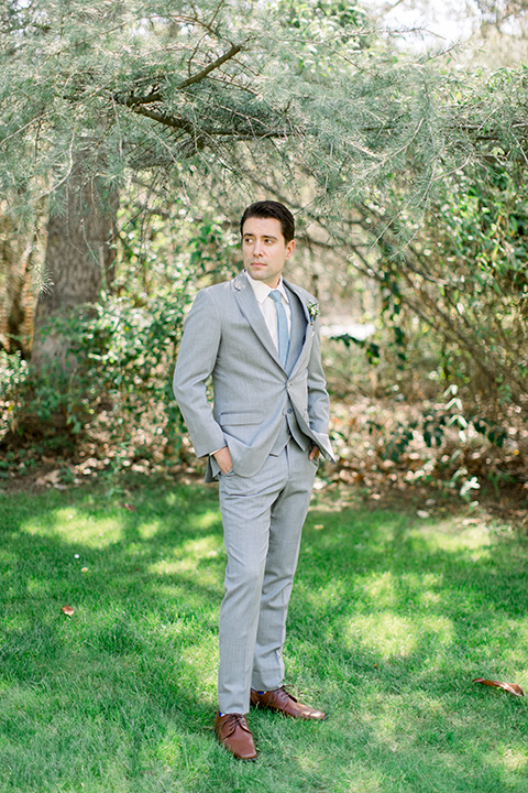 Temecula-Creek-Inn-Wedding-groom-with-hands-in-pockets