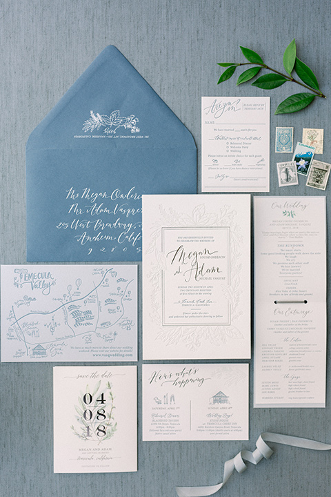 Temecula-Creek-Inn-Wedding-invitations-in-blue-envelopes-and-white-paper