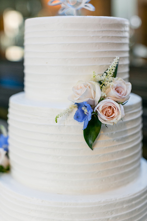 white cake with simple floral accents