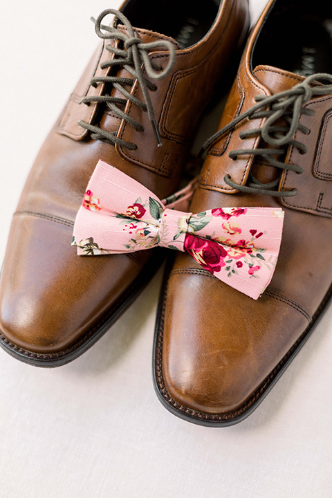 men's brown dress shoes with floral bow tie