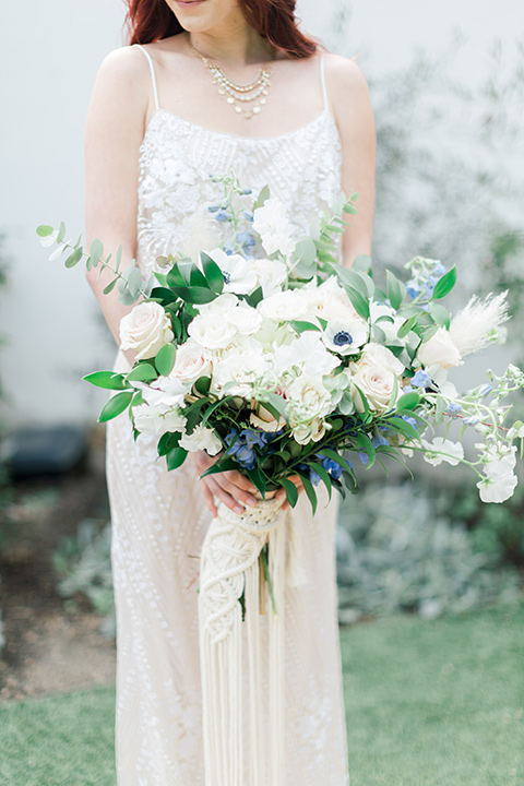 bride close up with white floral boquet