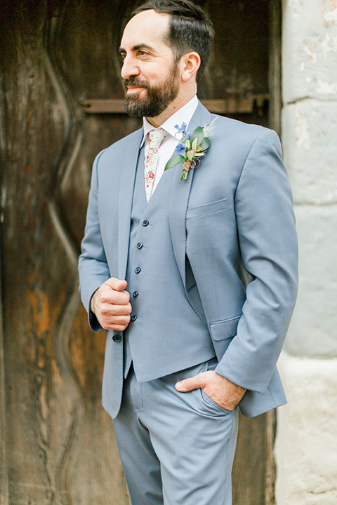 groom in light blue suit and floral tie
