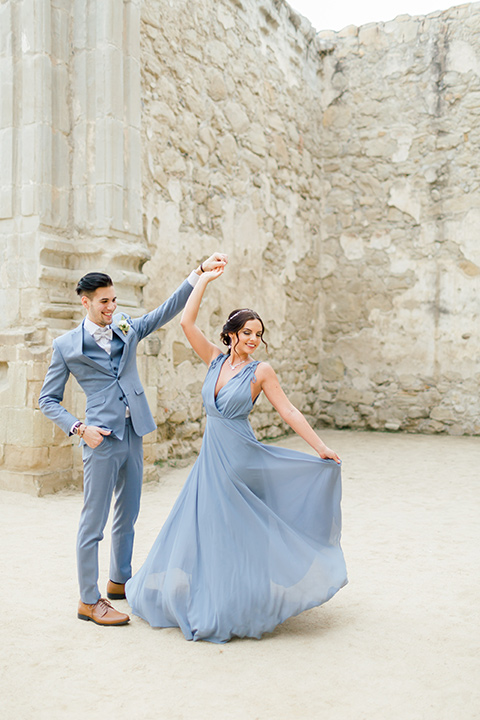 bridesmaid in a light blue gown with a light blue suit
