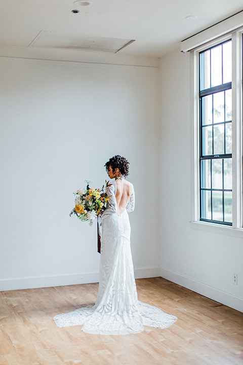 modern Moroccan shoot bride in a white lace gown with long sleeves and a v neck line