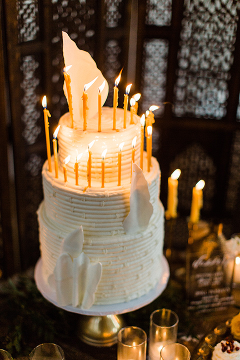 modern Moroccan shoot cake with white frosting and tall candles