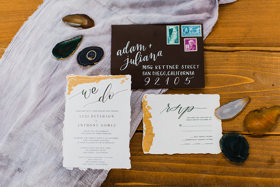 modern Moroccan shoot white invitations with black envelopes and gold accents
