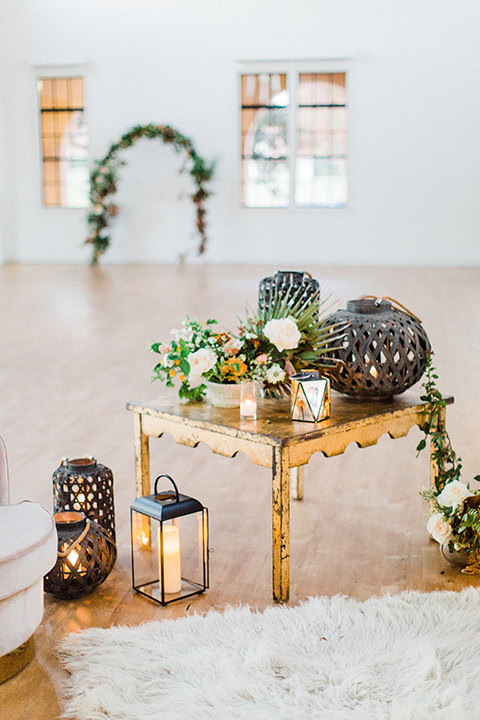 modern Moroccan shoot gold tables and green florals