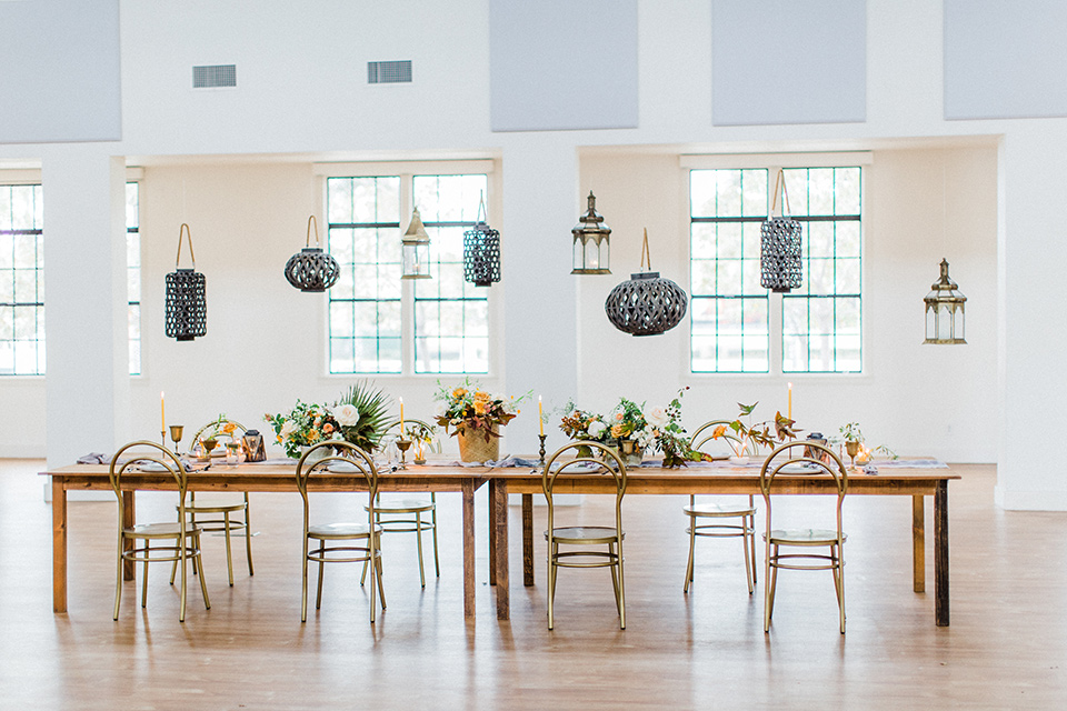 modern Moroccan shoot wooden table with gold accents and green florals