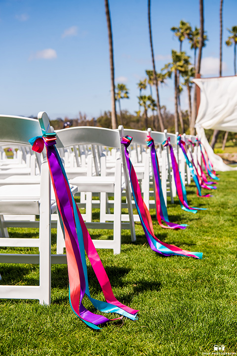 white chairs with colorful linen