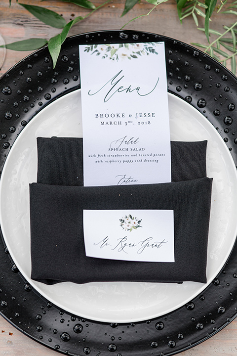 Oak-Meadows-Shoot-table-flatware-and-linens-with-black-charger-plates-and-white-menu-cards