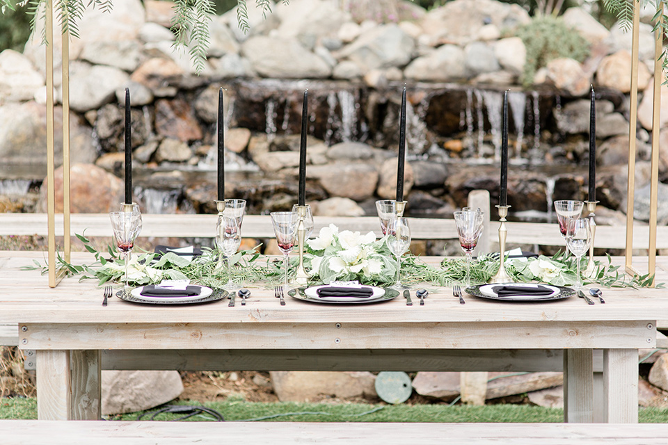 Oak Meadows table set up with a white wooden table and flowers