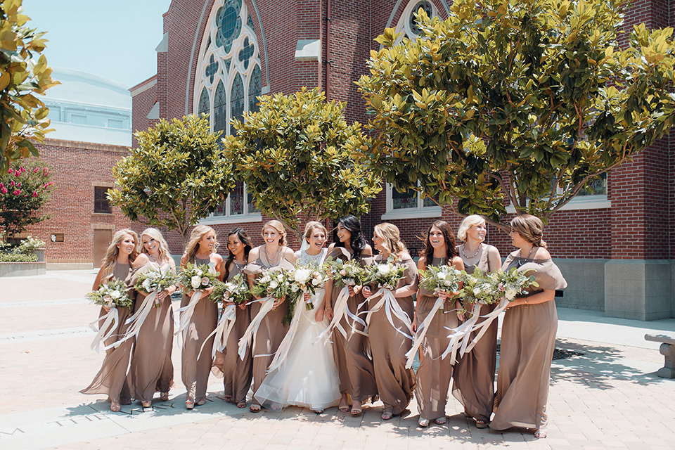 orange-county-wedding-bridesmaids-in-a-taupe-colored-dress-bride-in-a-two-piece-ball-gown-with-lace-detailing