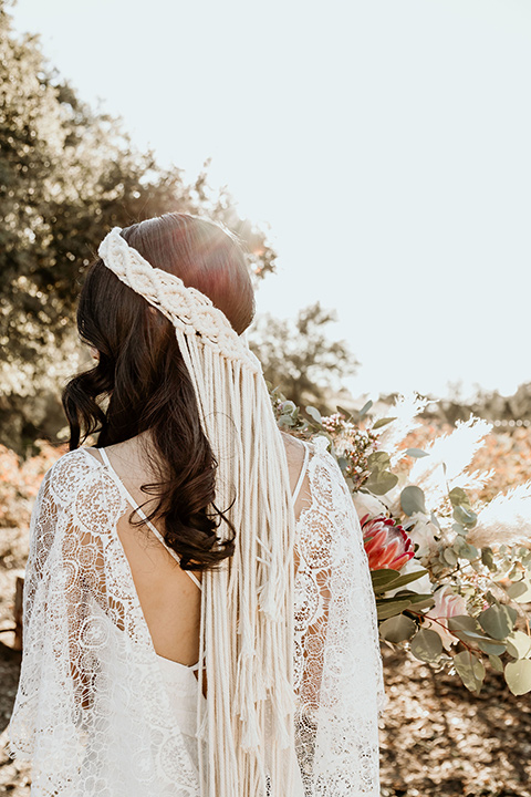 Owl-Creek-Farms-shoot-brides-macrame-headpiece-bide-in-a-flowing-boho-gown-with-sleeves