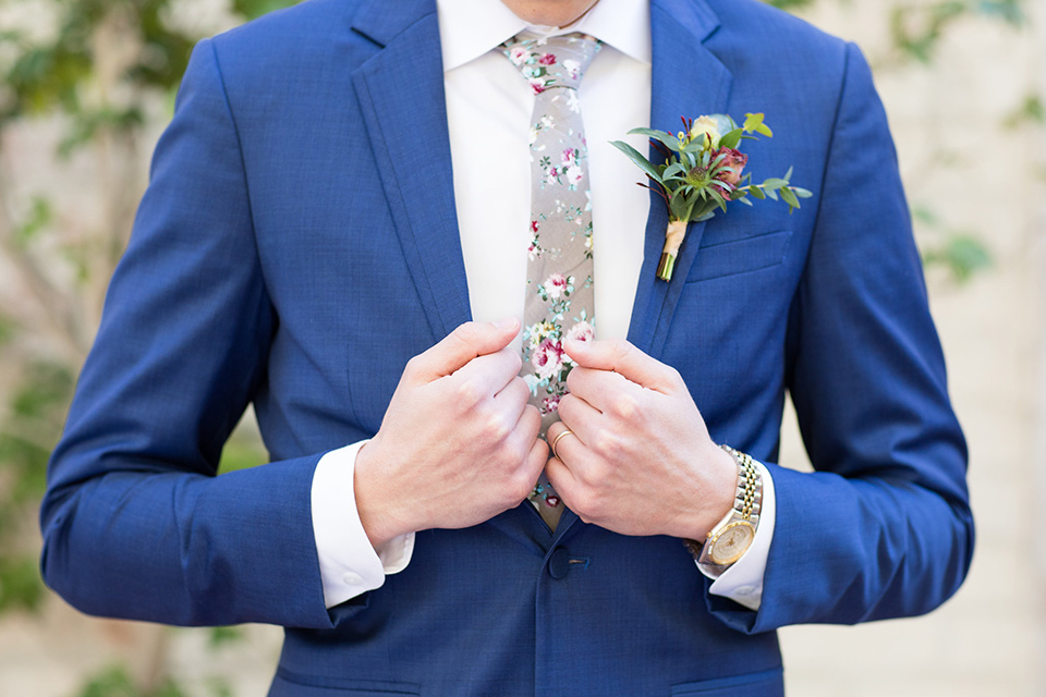 the groom look with a cobalt blue suit and light grey floral neck tie