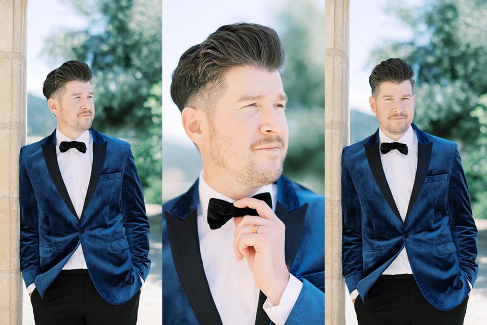 groom in a blue velvet tuxedo and black bow tie