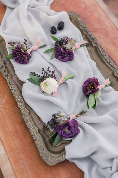 rancho-las-lomas-wedding-boutionneres-with-purple-flowers