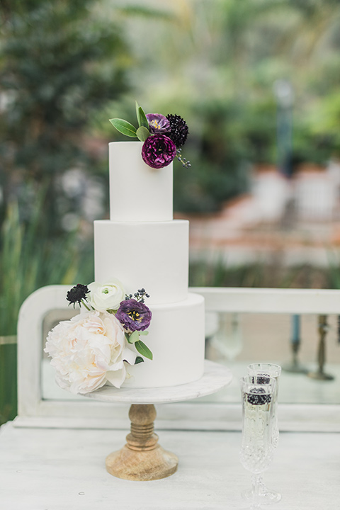 rancho-las-lomas-wedding-cake-with-white-fondant-and-purple-flowers