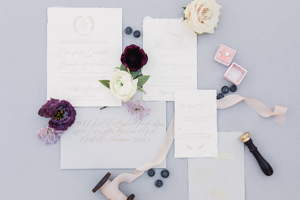 rancho-las-lomas-wedding-invitations-on-white-paper-and-purple-calligraphy