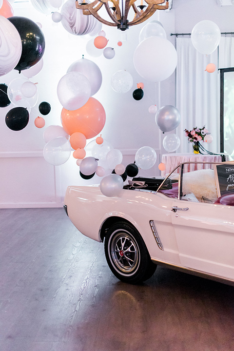 rock-n-roll-wedding-style-car-with-balloons