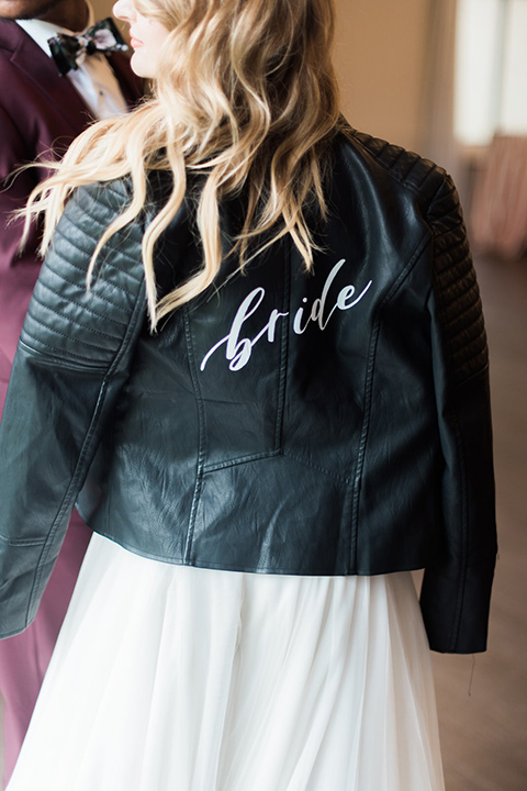rock-n-roll-wedding-style-leather-jacket-with-white-bride-calligraphy