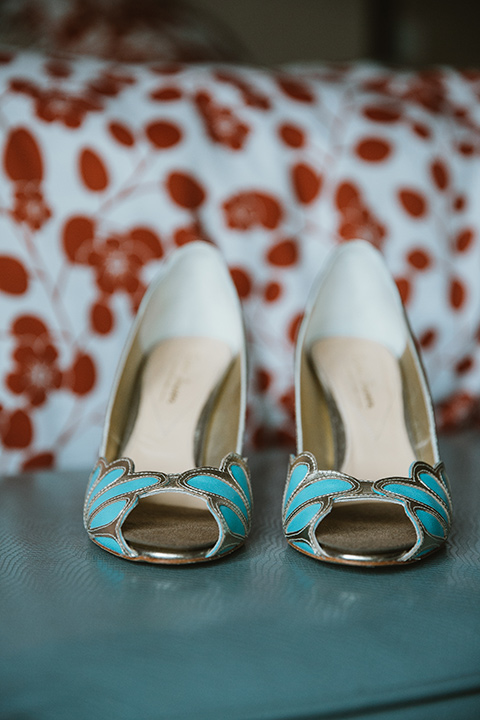 Moniker-Warehouse-Wedding-brides-shoes-with-teal-blue-accents