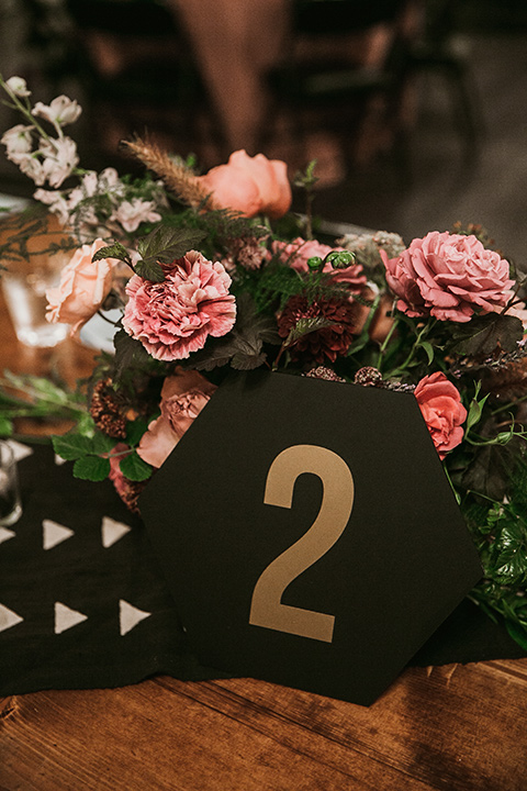 Moniker-Warehouse-Wedding-table-décor-with-black-numers-with-gold-geometric-design-and-pink-linens