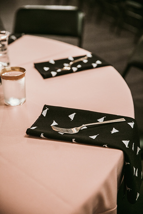 Moniker-Warehouse-Wedding-table-linens-in-light-pink-with-black-decor