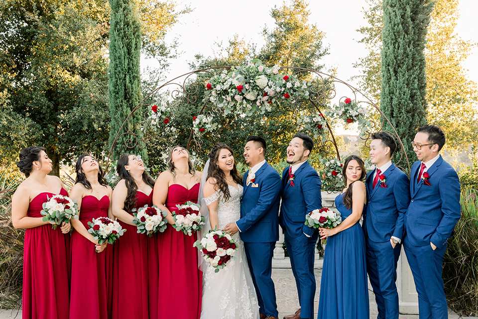 groomsmen in blue suits and groomslady in a blue dress
