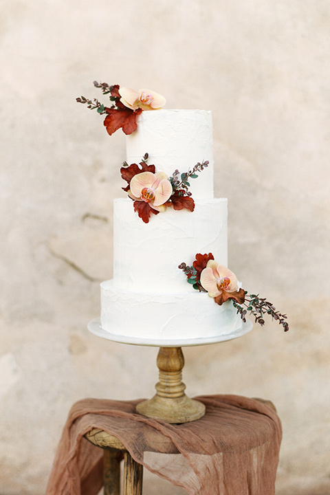 san-gabriel-mission-wedding-shoot-cake-with-white-tiers-and-floral-accents