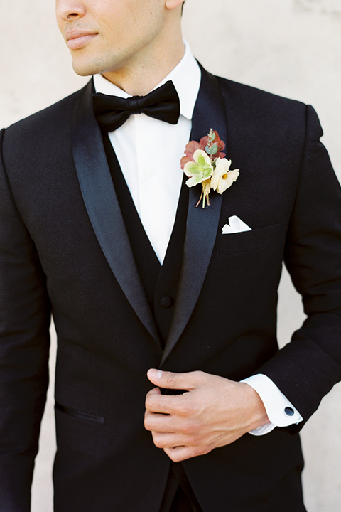 san-gabriel-mission-wedding-shoot-close-up-on-groom-wearing-a-black-tuxedo-with-black-bow-tie