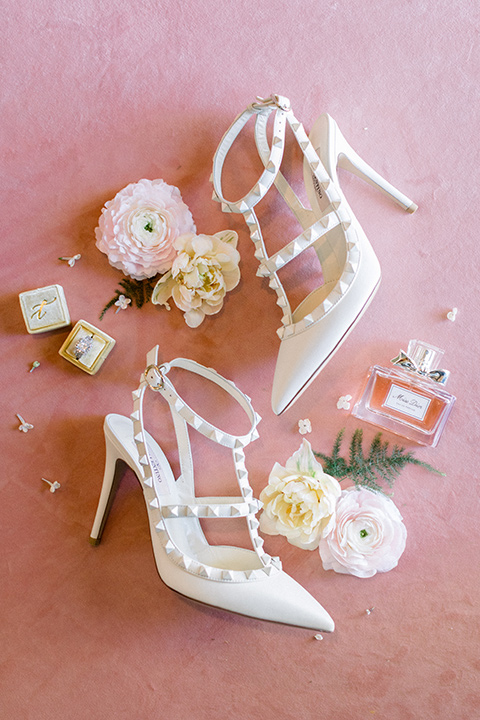 white pointed heels with metal detailing