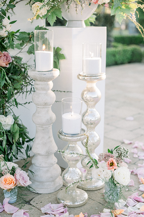 ceremony tall candles and florals