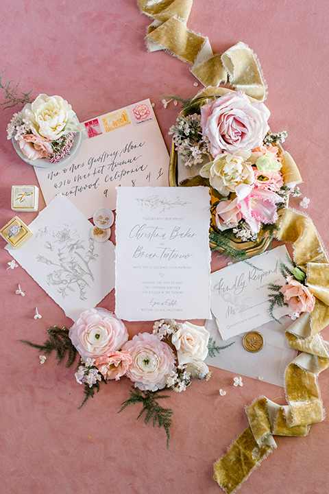 white invitations with pink and gold lettering