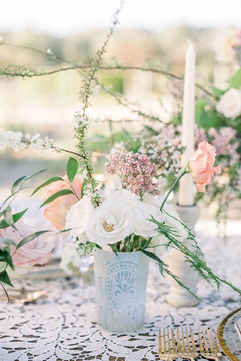 tall white candles on the reception tables