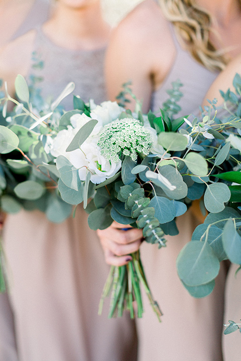 Circle-Oak-ranch-wedding-bridesmaids-florals-in-sage-greens-and-white