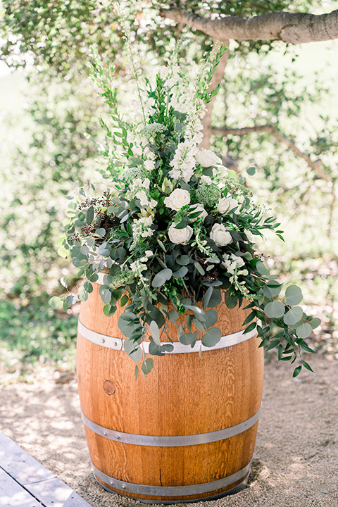 Circle-Oak-ranch-wedding-ceremony-décor-with-flowers-in-wine-barrels