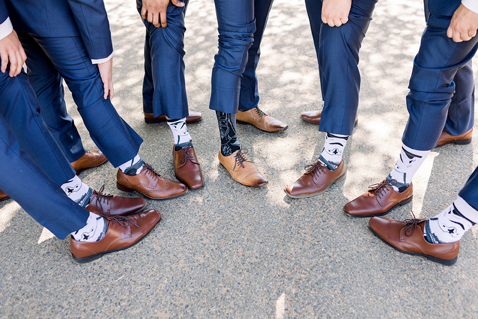 Circle-Oak-ranch-wedding-groom-and-groomsmen-socks-with-star-wars-themes-on-them