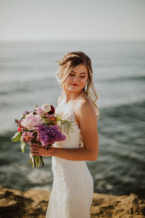 Sunset-Cliffs-Elopement-bride-looking-over-shoulder-in-a-lace-white-gown-with-thin-straps