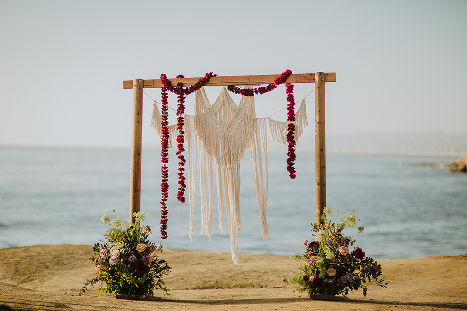 Sunset-Cliffs-Elopement-ceremony-arch-with-wood-and-hanging-floral-design