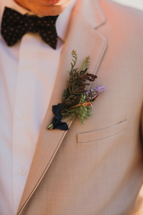 Sunset-Cliffs-Elopement-groom-attire-up-close-in-a-tan-suit-coat-with-black-pants-and-black-bow-tie