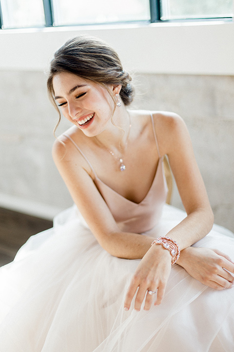 The-1912-Shoot-bride-sitting-bride-in-a-tulle-ballgown-with-a-sweetheart-neckline