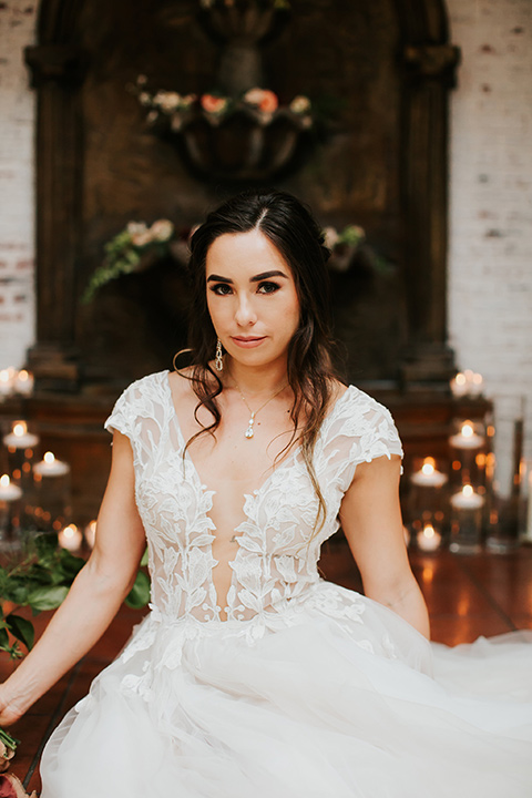 bride in a lace gown with a cap sleeve