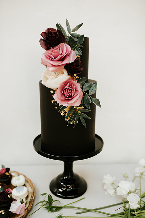 black two-tier cake with pink florals
