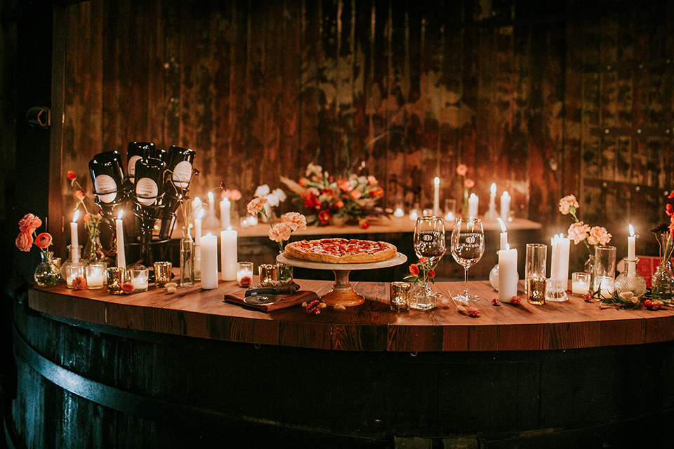 wooden table with candles and desserts